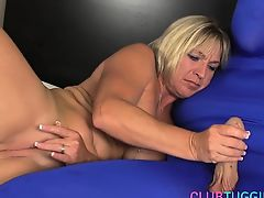 Busty milf jerks cock of a man in spandex