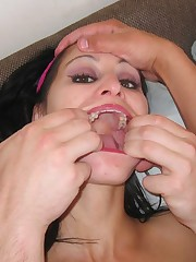 Brunette bimbo shoves two cocks in her big mouth