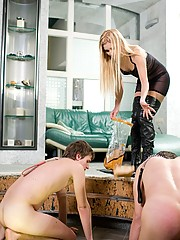 Rough blonde dominatrix feeds her pitiful doggy boys off her stiletto heels