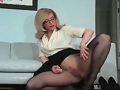 Sexy MILF Nina Hartley stripping